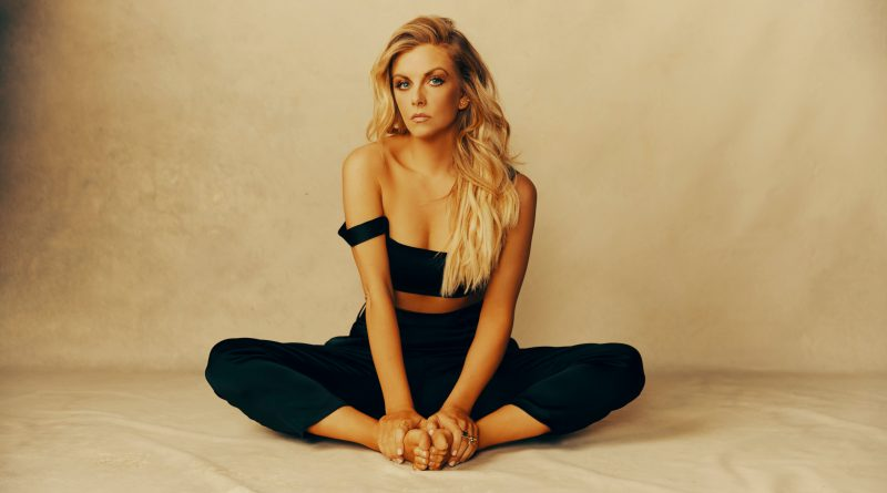 Lindsay Ell Sat with Legs Crossed